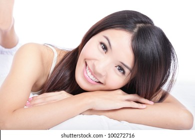 close up portrait of woman smile face lying on bed isolated on white background, model is a asian girl