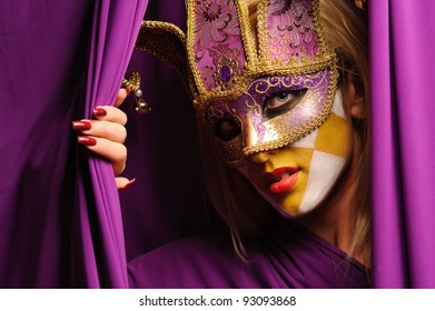 close up portrait of woman in violet carnival mask