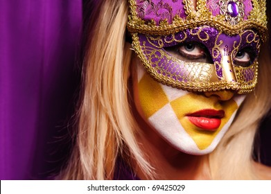 close up portrait of woman in violet mask