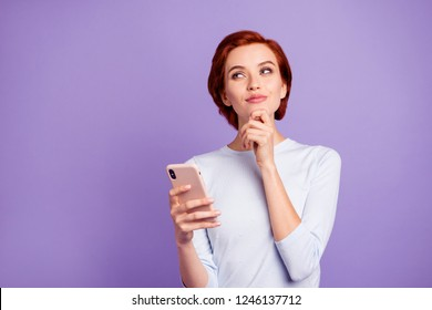 Close up portrait of wondering beautiful pretty charming she her girl holding telephone in hand another on chin imagine guy close not virtual wearing white casual sweater on violet background