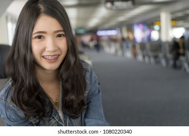 Close up Portrait young Asian woman in airport terminal.Traveler girl waiting for flight.