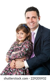 Close up portrait of young attractive businessman in suit with his little daughter on lap.Isolated on white background.