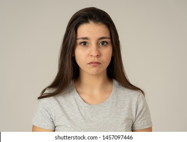 Close up Portrait of young attractive frustrated latin woman with furious face. Looking mad and disappointed in dislike. Isolated on neutral background. In human facial expressions and emotions.