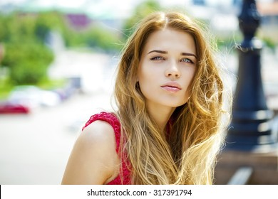 Close up Portrait, Young beautiful blonde woman posing outdoors in sunny weather