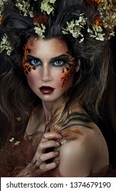 close up portrait of young beautiful girl with flower professional makeup. elf princess with flower crown on head.  Halloween makeup. bright face art. spring fairy of flowers