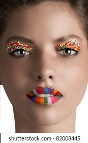 close up portrait of a young beautiful girl with creative colored make up
