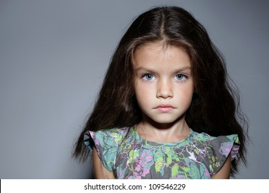 close up portrait of young beautiful little girl with dark hair