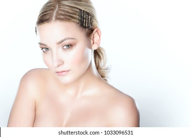 Close up portrait of a young beautiful model with perfect skin and nude wet make up. Isolated on white background. Skin care concept. Studio shot. Text space