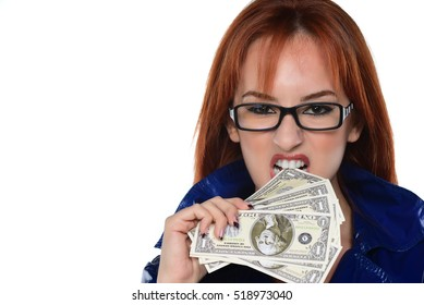 Close up portrait of Young beautiful redhead woman holding dollars. crime concept