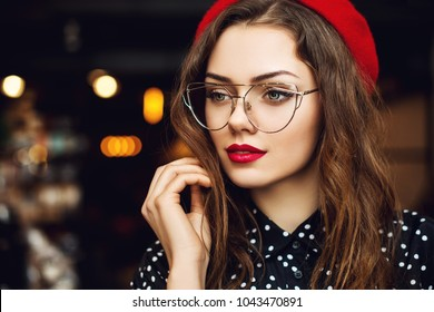 e83d6c6a795d Close up portrait of young beautiful woman wearing stylish glasses, red  beret, polka dot