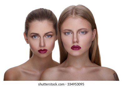 close up portrait of young beautiful women with bright make up on white background