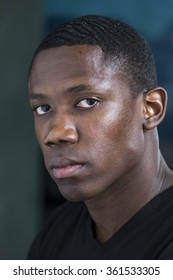Close up portrait of a young black man, serious expression