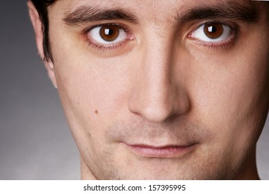 close up portrait of young brown eye man