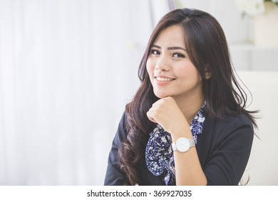 close up portrait of young business woman working on her office