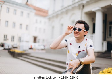 Close up portrait of young cheerful  man on european streets. Positive, freedom concept