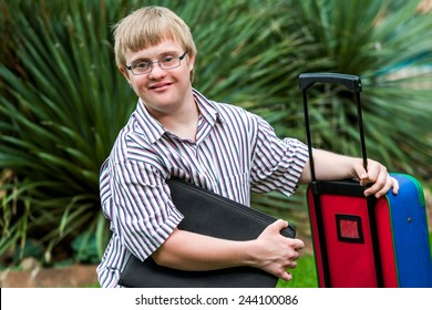 Close up portrait of young Down syndrome student with file and trolley.