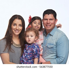 Close up portrait of young family of four isolated on white background