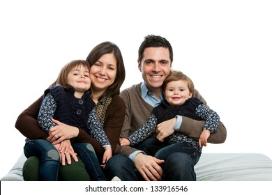 Close up portrait of young family on couch.isolated.