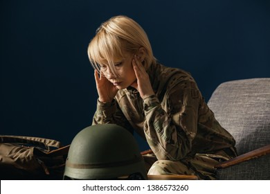 Close up portrait of young female soldier. Woman in military uniform on the war. In doctor's consultation, depressed and having problems with mental health and emotions, PTSD, rehabilitation.