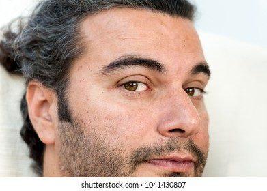 Close up portrait of a young handsome man looking into the camera