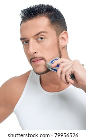Close up portrait of young handsome man with perfect skin and hair. Shaving by electric shaver