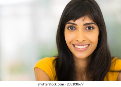 close up portrait of young indian woman at home