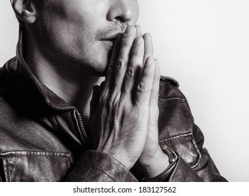 Close up portrait of young man praying