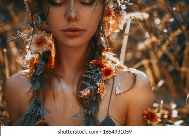 close up portrait of young and tender woman on a feild at sunset
