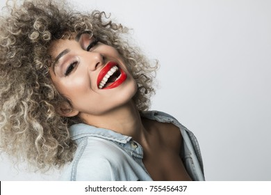 close up portrait of young woman with red lips laughing, horizontal shot, studio white