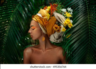 close up portrait of young woman in turban with flowers