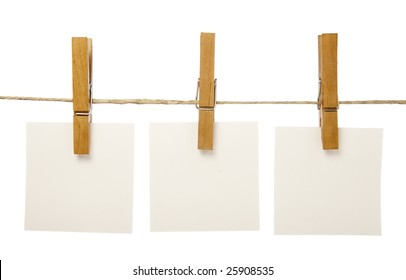 close up of post it reminders and clothespins attached to a rope on white background with clipping path
