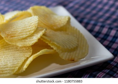 Close up potato chips on white dish