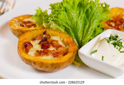 Close Up of Potato Skins with Cheese and Bacon Appetizer with Dipping Sauce