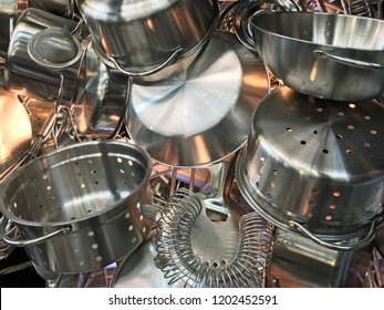 Close up of pots, pans, colanders and strainers collection