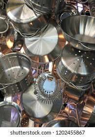 Close up of pots, pans, colanders, and strainers  collection