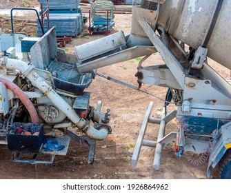Close up pouring concrete mixer with pump without pump mixer