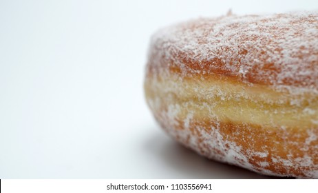 A close up of powder icing sugar on a donuts. Macro food photography with copy space