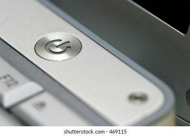 Close up of the power on and off button on a laptop