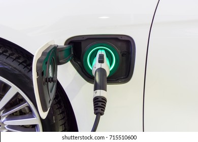 Close up Power supply connect to electric car for add charge to the battery. Charging re technology industry transport which are the future of the Automobile.