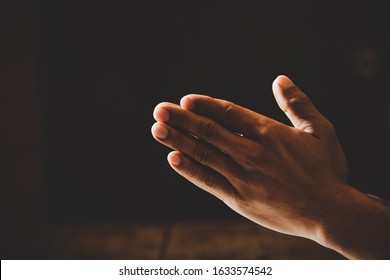 Close up prayer hand pray in church, Pastor pray to God, with blank copy space, Spirituality and Religion Concept