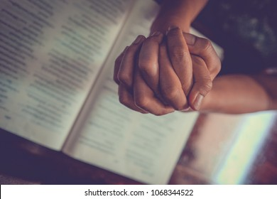 Close up prayer's hand pray in church, Pastor pray to God with BIBLE, top view with blank copy space
