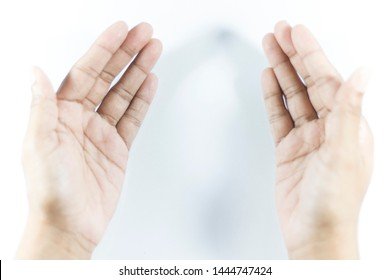 Close up of Praying Female Brown Hands on White Background.