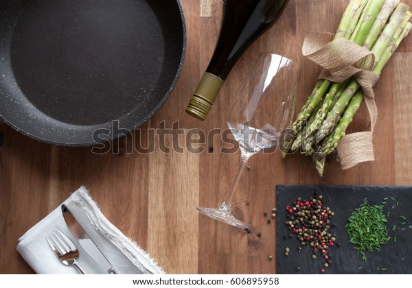 Close up preparing for a eating with fried asparagus on a wooden table