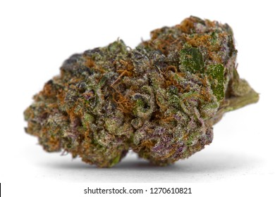 Close up of prescription medical marijuana and recreational weed hybrid strain sticky flower bud isolated on a white background
