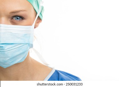 Close up of a pretty, blue-eyed, female surgeon. Half face composition. Looking confident and professional