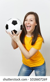Close up pretty European young smiling happy woman, football fan or player in yellow uniform holding soccer ball isolated on white background. Sport, play football, health, healthy lifestyle concept