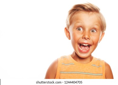 Close up of pretty little boy with blond hair screaming loudly, trying to scare friend in school. Copy-space. Studio shot