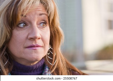 Close up of a pretty middle aged woman looking to the right.