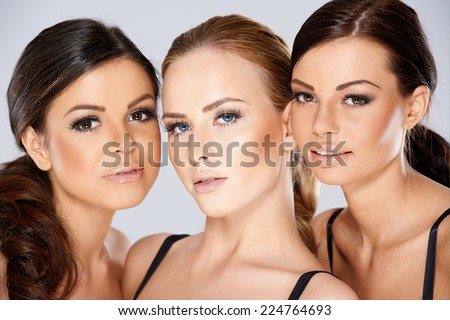 905211e914d19 Close up Pretty Young Women Faces Looking at Camera. Captured in Studio on  Gray Background