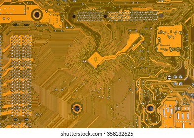 Close up of a printed orange computer circuit board